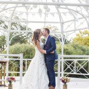 arch, confetti, bride & groom, suit