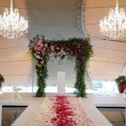 aisle, arch, chandelier, petals