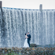 feature shot, bride and groom, waterfall