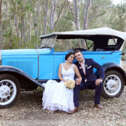 bride and groom, car