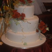 3 tier cake, floral accents, roses, three tier cake, white