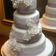 4 tier cake, floral accents, four tier cake, purple, white