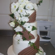 4 tier cake, brown, floral accents, four tier cake, white