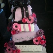 4 tier cake, black, four tier cake, pink, purple, white