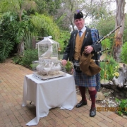 scottish wedding, white doves, doves, bagpiper